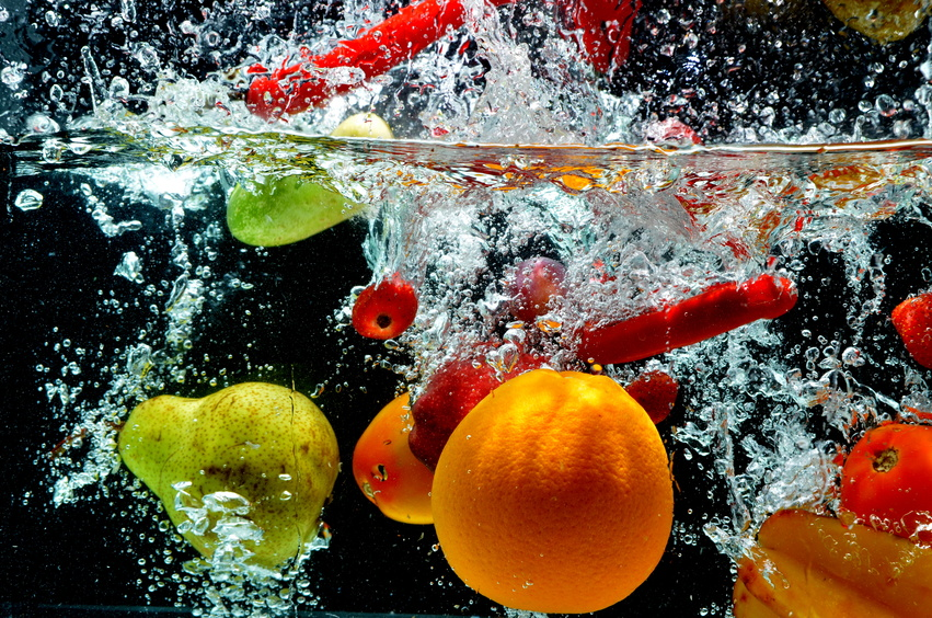 Various fresh and healthy fruit picture taken as they submerged dramatically into a clean water.